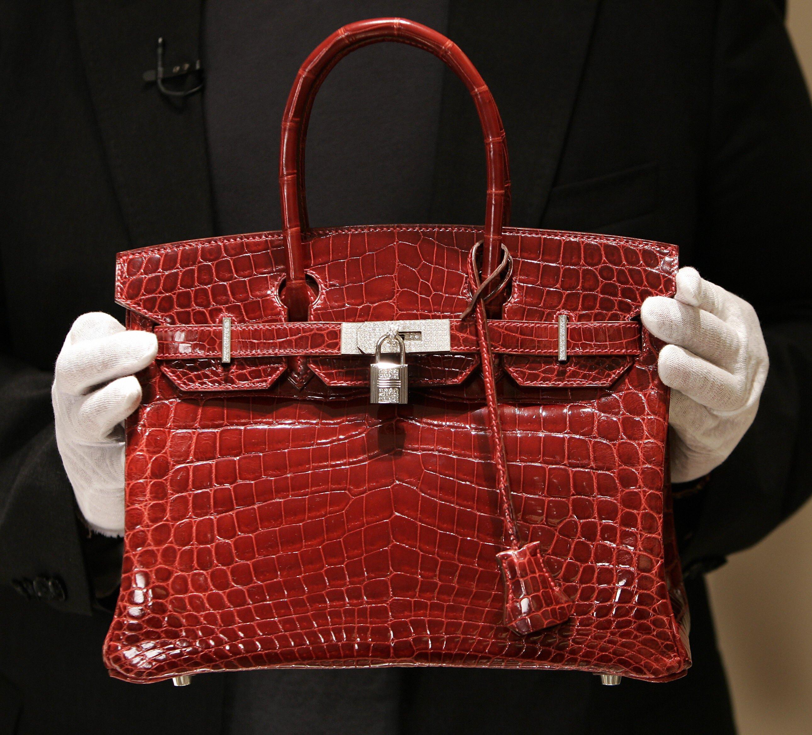97602e7cba73 low price new york united states a employee holds a 129000 usd crocodile  hermes birkin bag